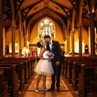 Bride and Groom are married in church wedding flowers by blank slate events photo by Jerritt Clark