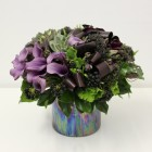 Flower Arrangement in shades of purple calla lilies and ranunculus